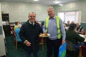 Lions Bill Thompson and Les Johnson serving fish and chips at Rillington Community Centre