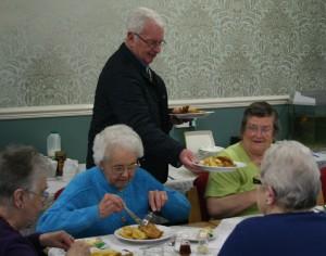 Lion Steve Garside serves fish and chips at Rillington Community Centre