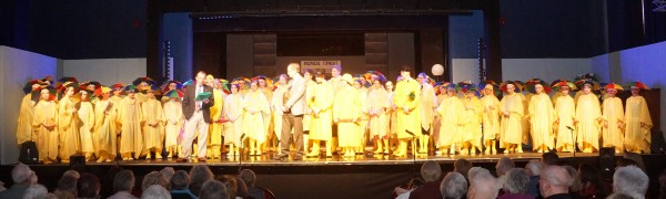 The cast of Ryedale Youth Theatre's excellent production of Singing in the Rain welcome Malton Lions on stage.