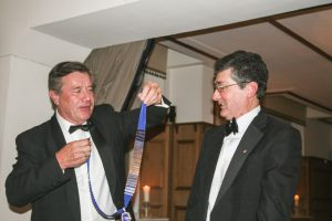 Past President Lion Nick presents Ian with his chain of office